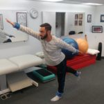 Soccer player showing active therapy exercises Tustin Chiropractic clinic