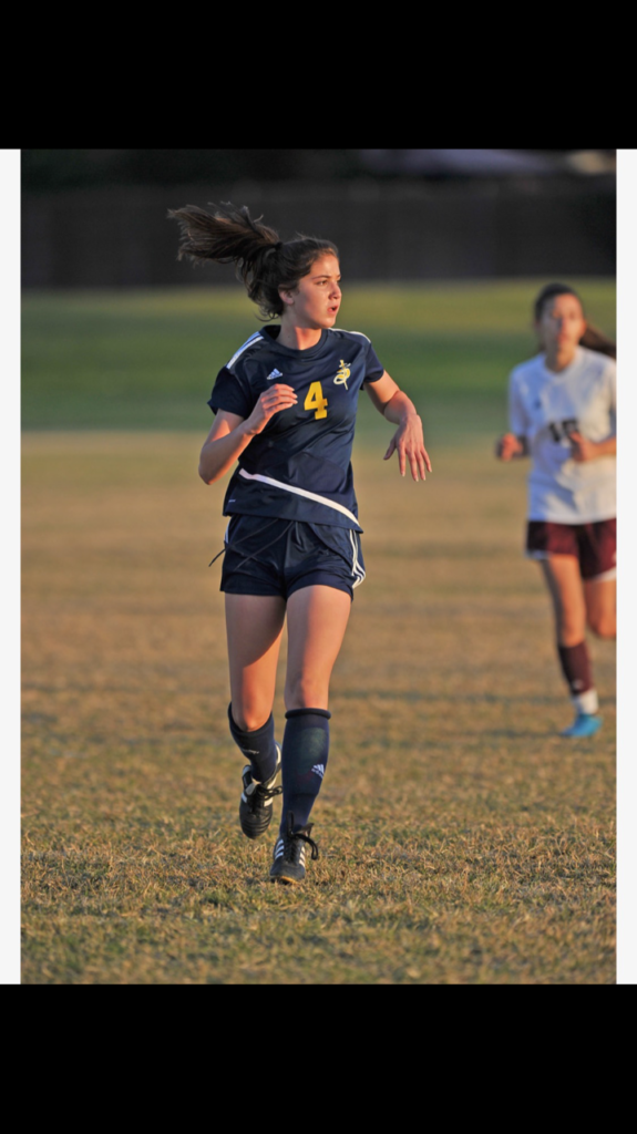 Soccer player running in game