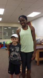 Professional Basketball Star Nneka Ogwumike with young fan