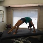 Gymnastics star doing high back bridge at Tustin chiropractors facility
